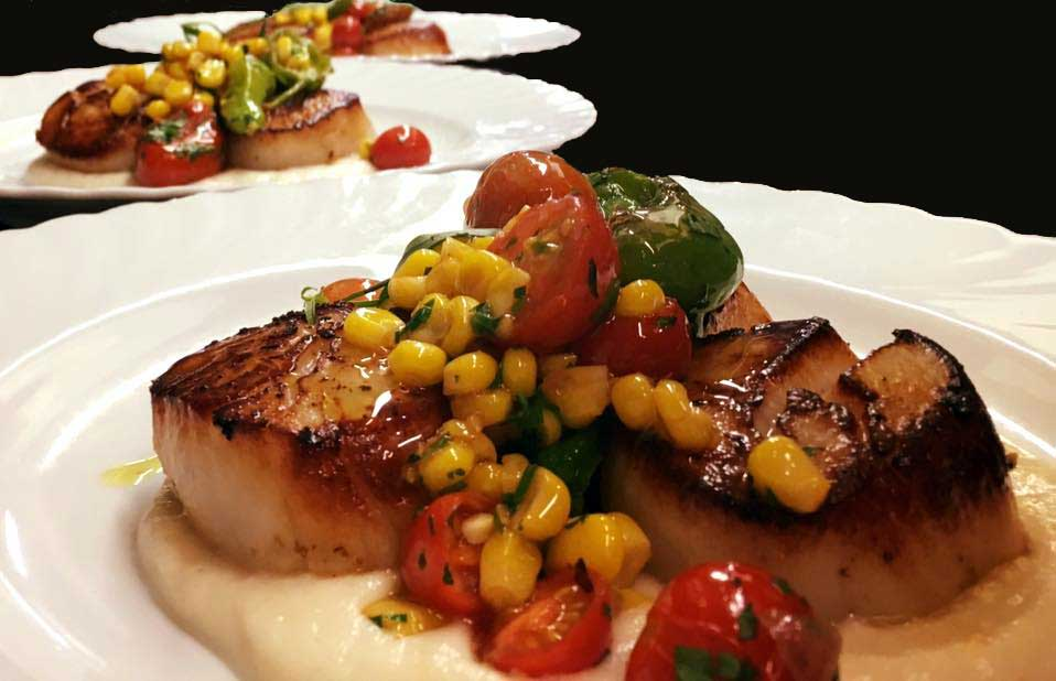 Seared New Bedford scallops with sunchoke puree, sweet corn, cherry tomatoes and blistered shishito peppers