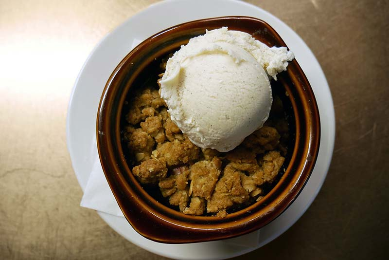 Maple sweetened pink lady apple crumble with your choice of Soco vanilla bean or salted caramel ice cream