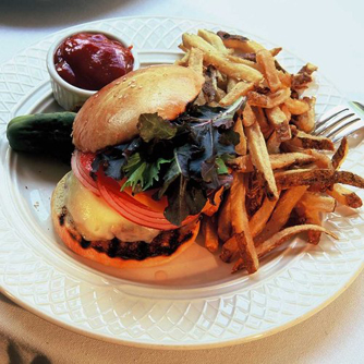 Tavern Burger with Applewood smoked bacon, caramelized onions, cheddar, hand cut fries