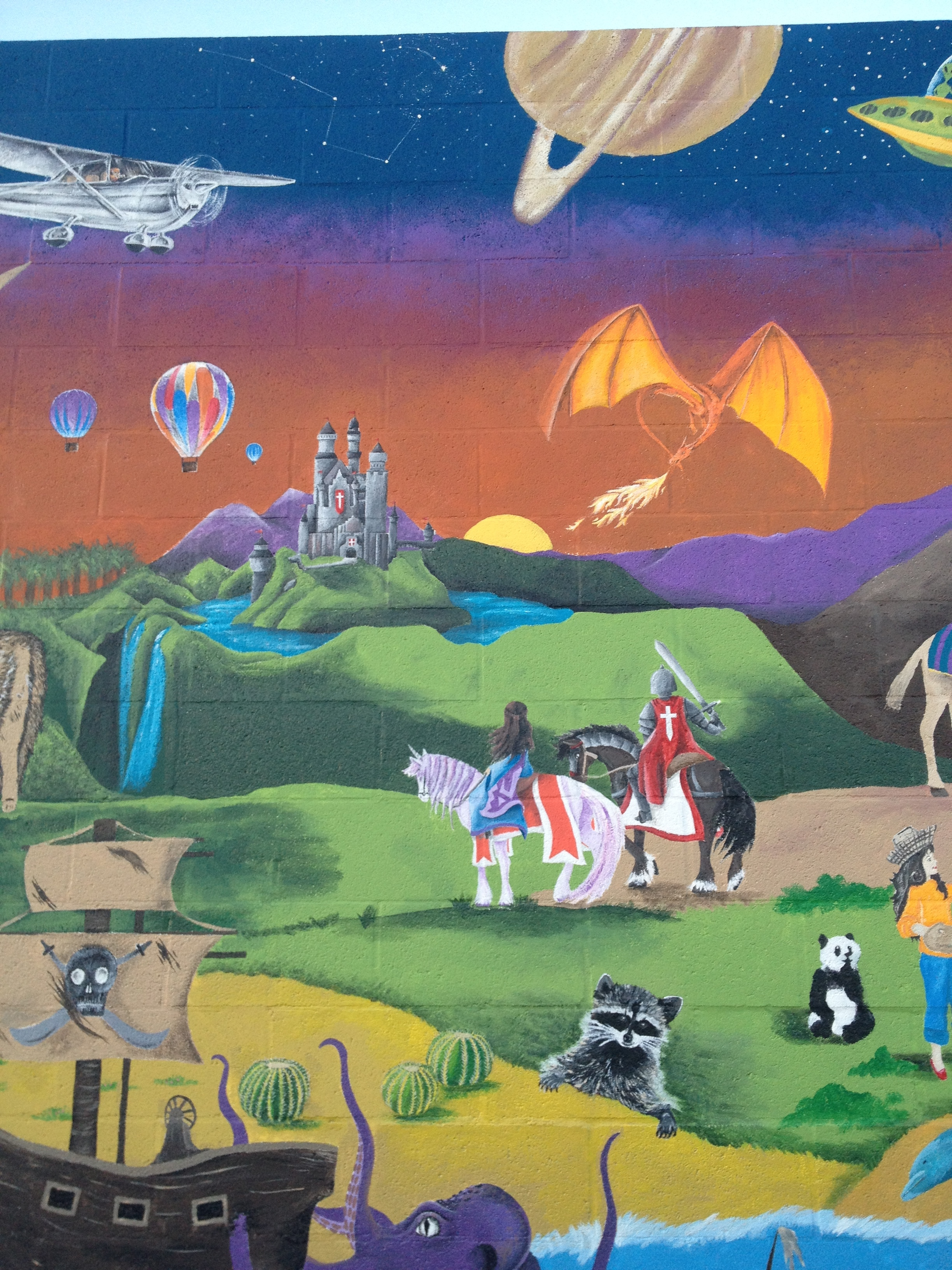 Group mural for elementary school dodgeball wall in Riverside, CA. (Section by artist: medieval castle, knight and princess, and dragon)   Finished November 2016