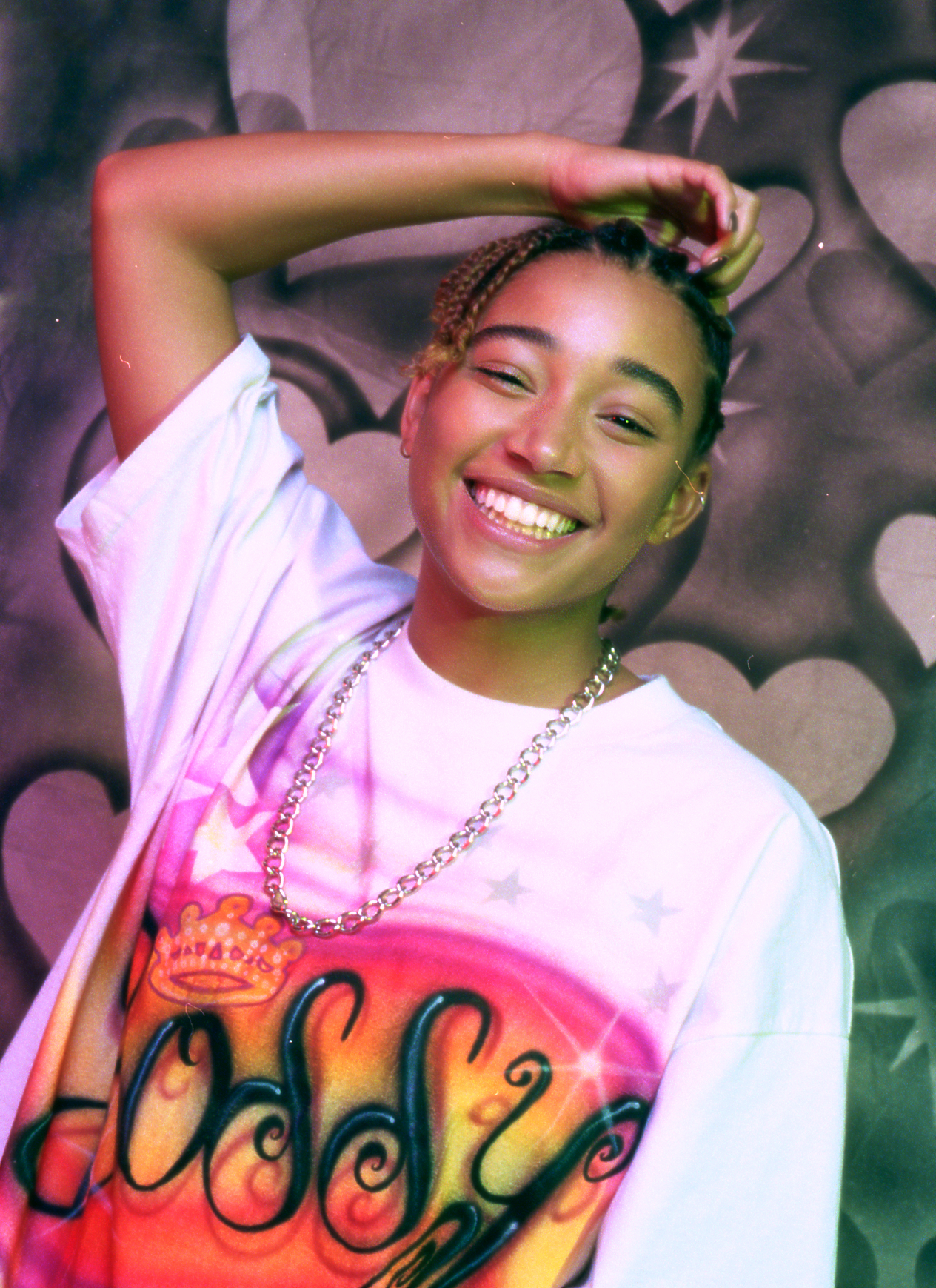 Amandla wears NO SESSO t-shirt, VINTAGE chain.