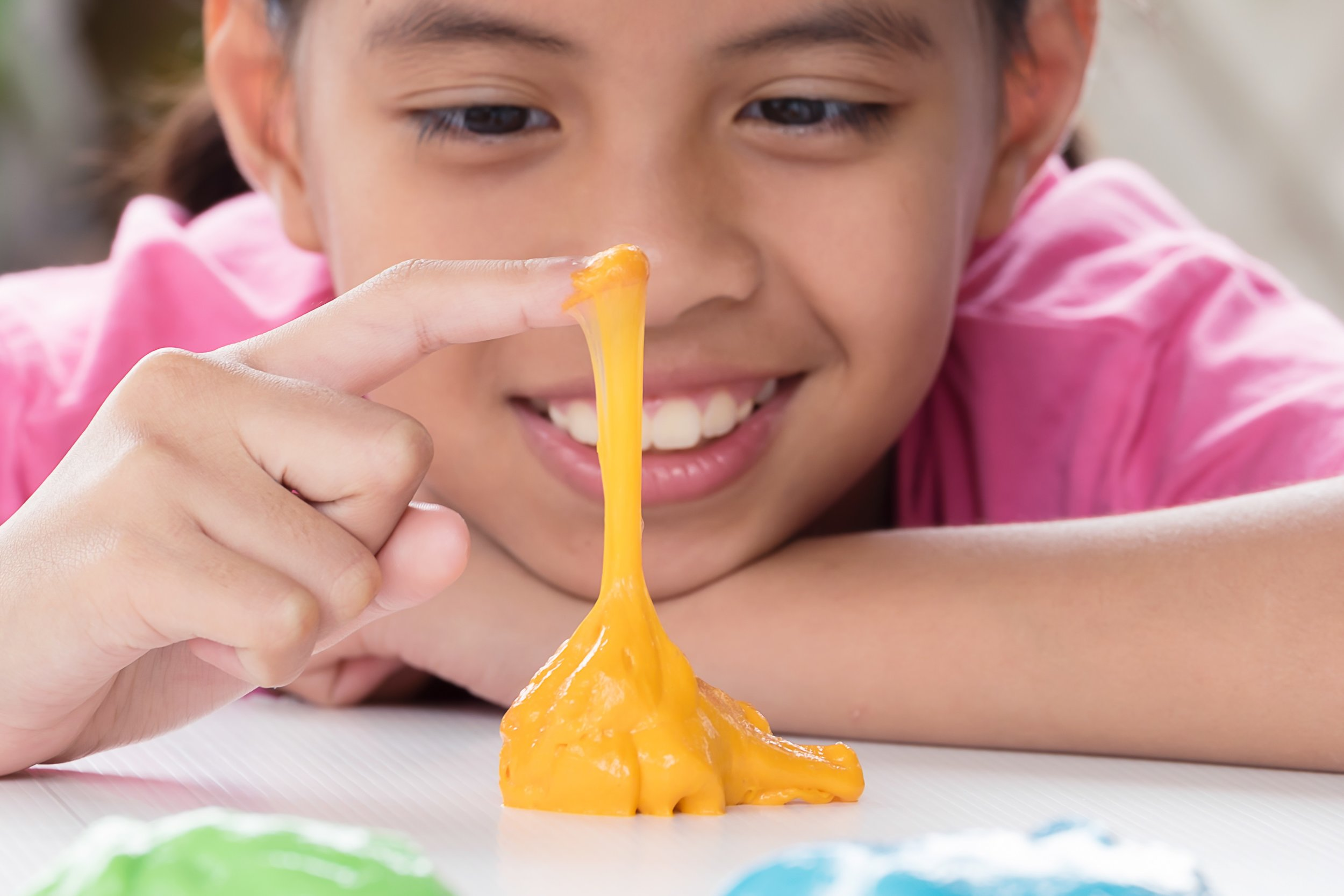 stock-photo-kid-playing-hand-made-toy-called-slime-543019921.jpg