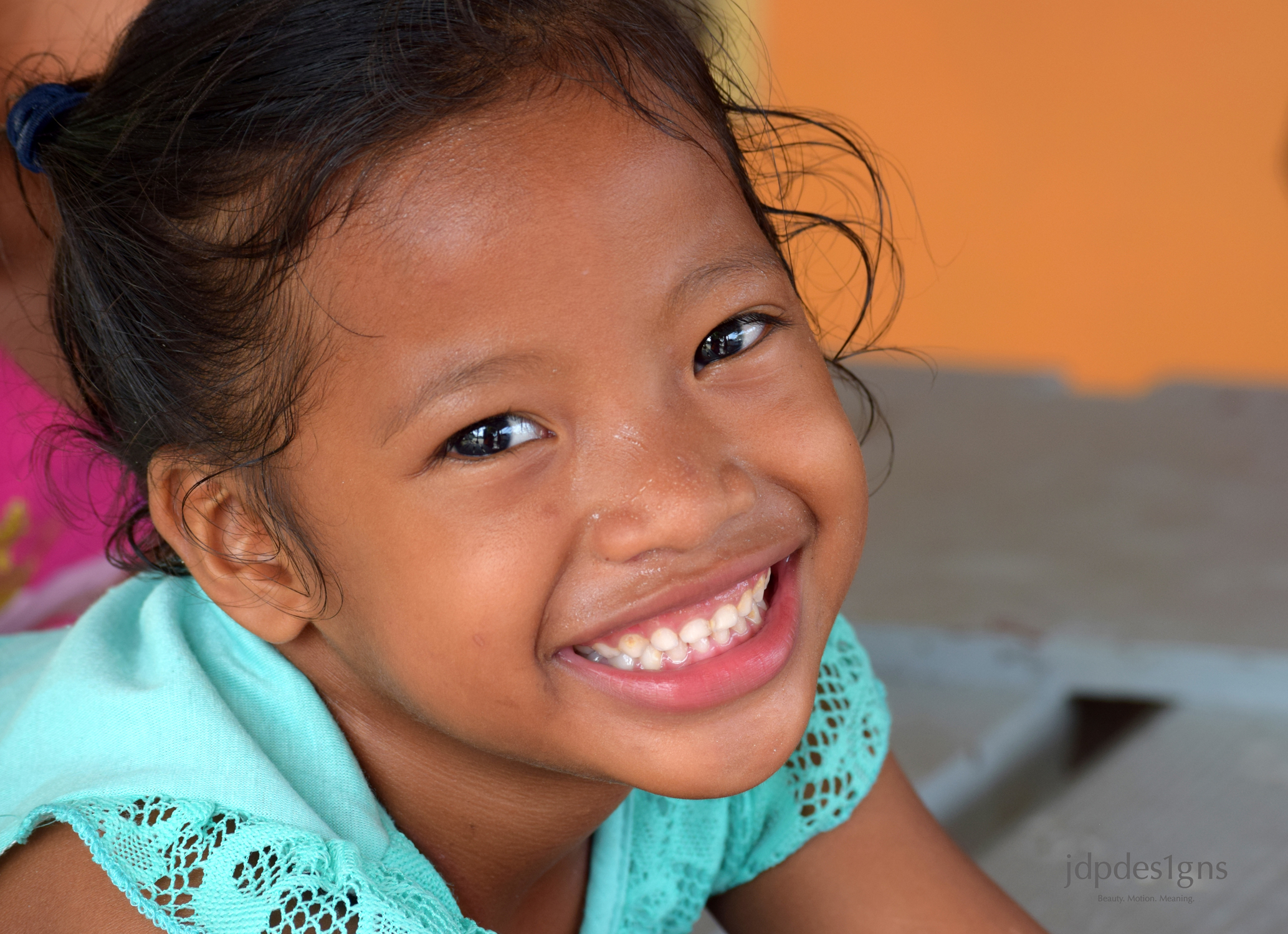 Green Shirt Little Girl Smile Resize.jpg