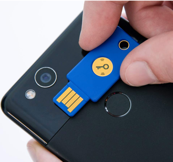 The  Yubikey 5 (black)  and  Yubico Security Key NFC (blue)  both provide NFC touch authentication for mobile devices.