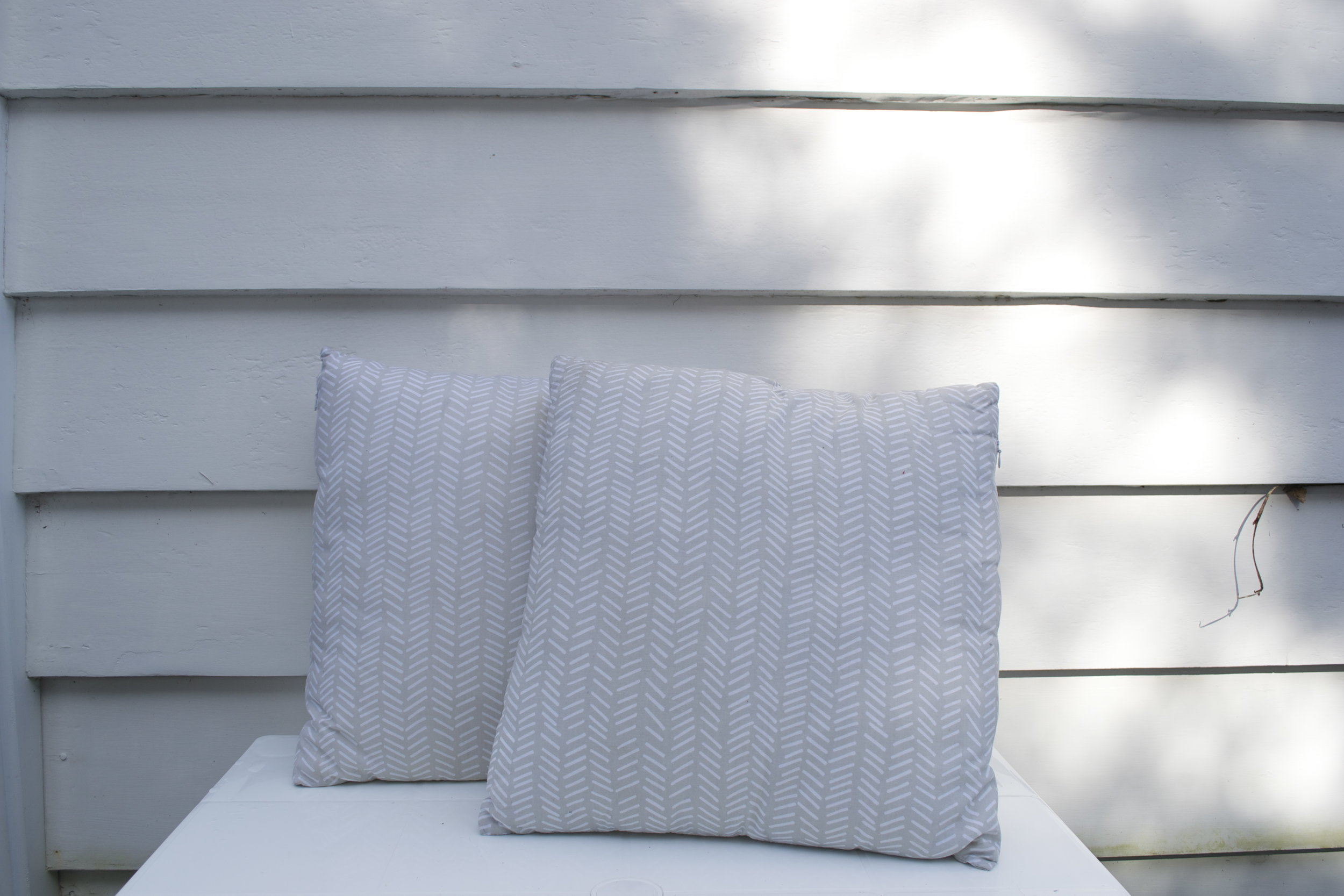 patterned cushion x2 $3 each