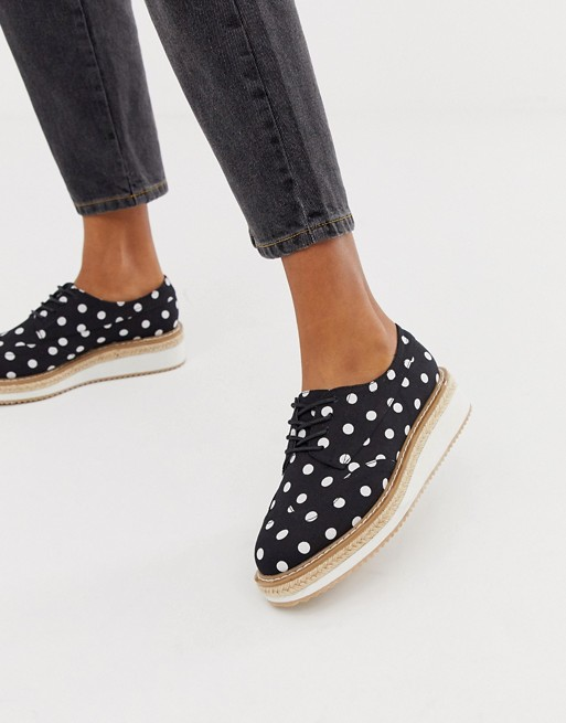 ASOS DESIGN - Maypole flat shoes in polka dot ($64 CAD)