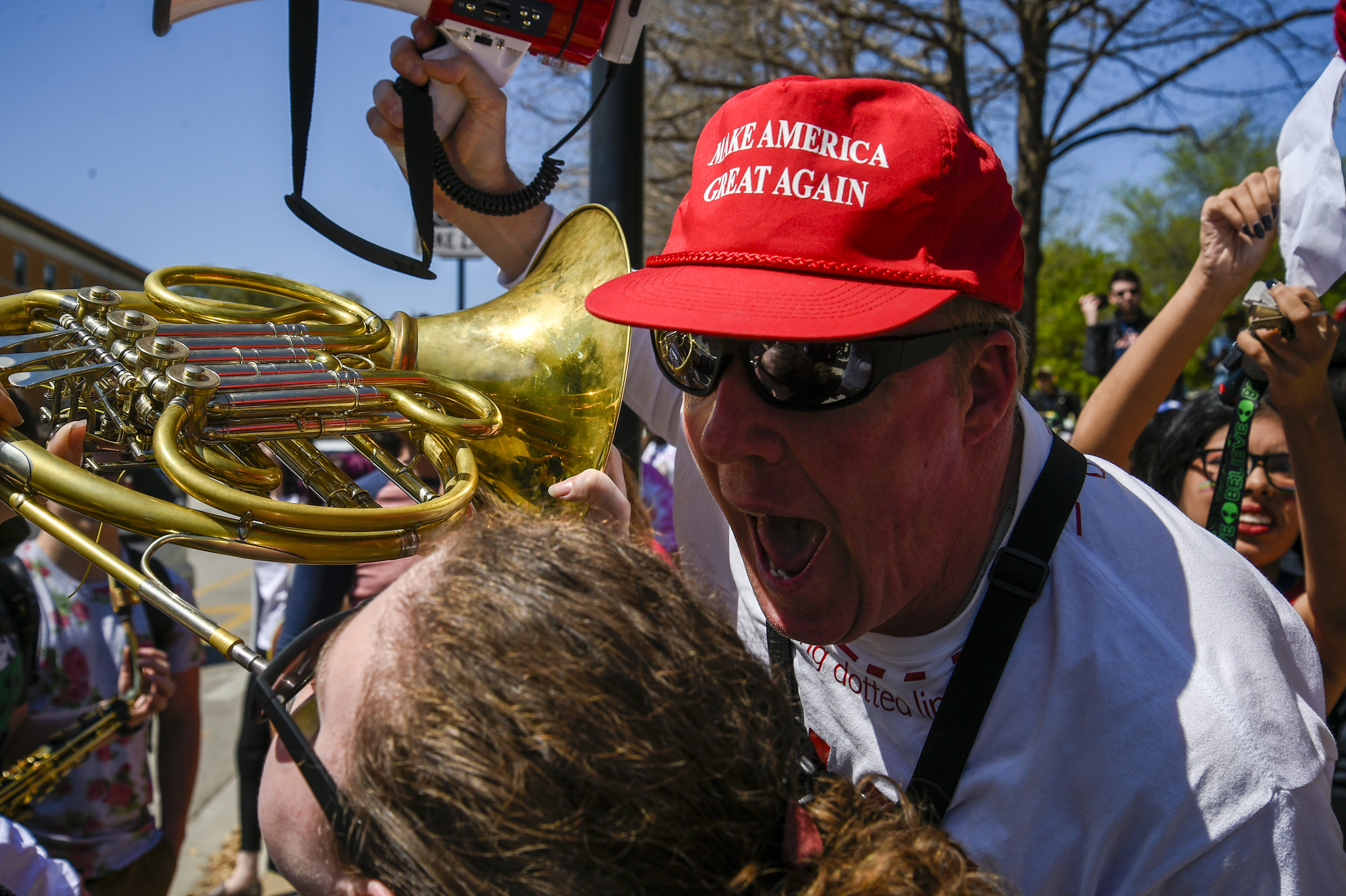 Jim Gilles yells into the ear of Kelli Williams, a UNT music performance student. Williams was previously playing her french horn loudly in Gilles' ear.