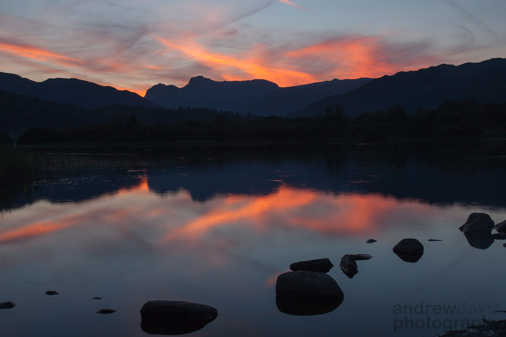 Sunset over the Langdale Pikes reflected in Elterwater, Cumbria