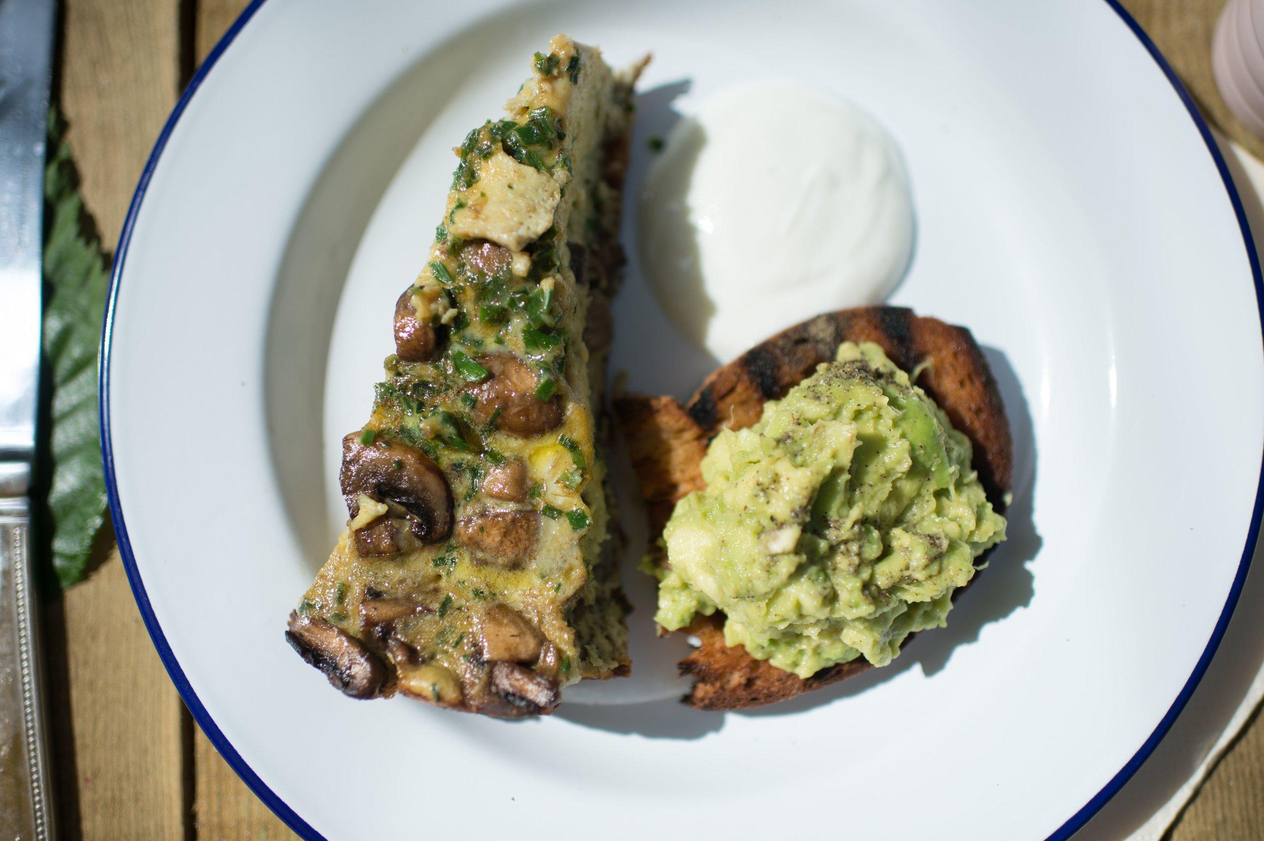 Mushroom and herb frittata with garam masala, mashed avocado