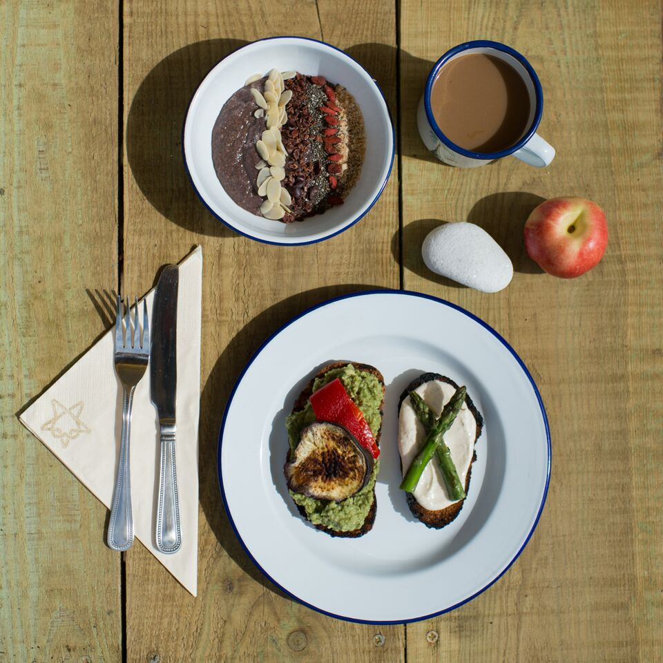 Acai bowls topped with toasted coconut, flaked almonds, chia seeds, goji berries and cacao nibs. Build your own breakfast bruschetta with avocado pea and mint puree, Lucy's banging hummus with toasted cumin seeds, chargrilled vegetables.
