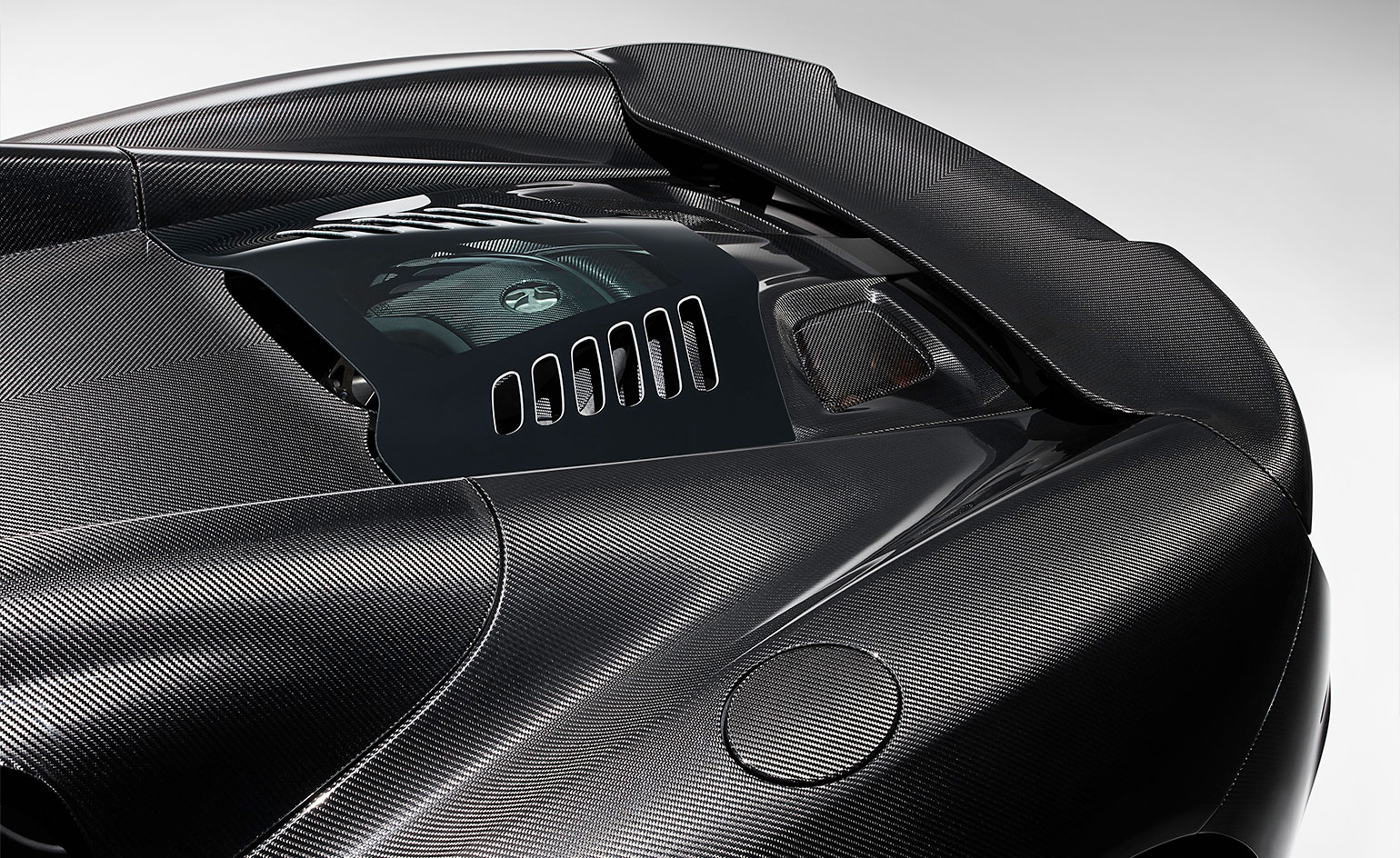 Tailored carbon-fibre helps to expose the functional material, not hide it