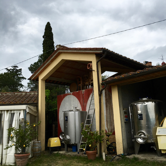 Outdoor stainless and concrete fermentation tanks