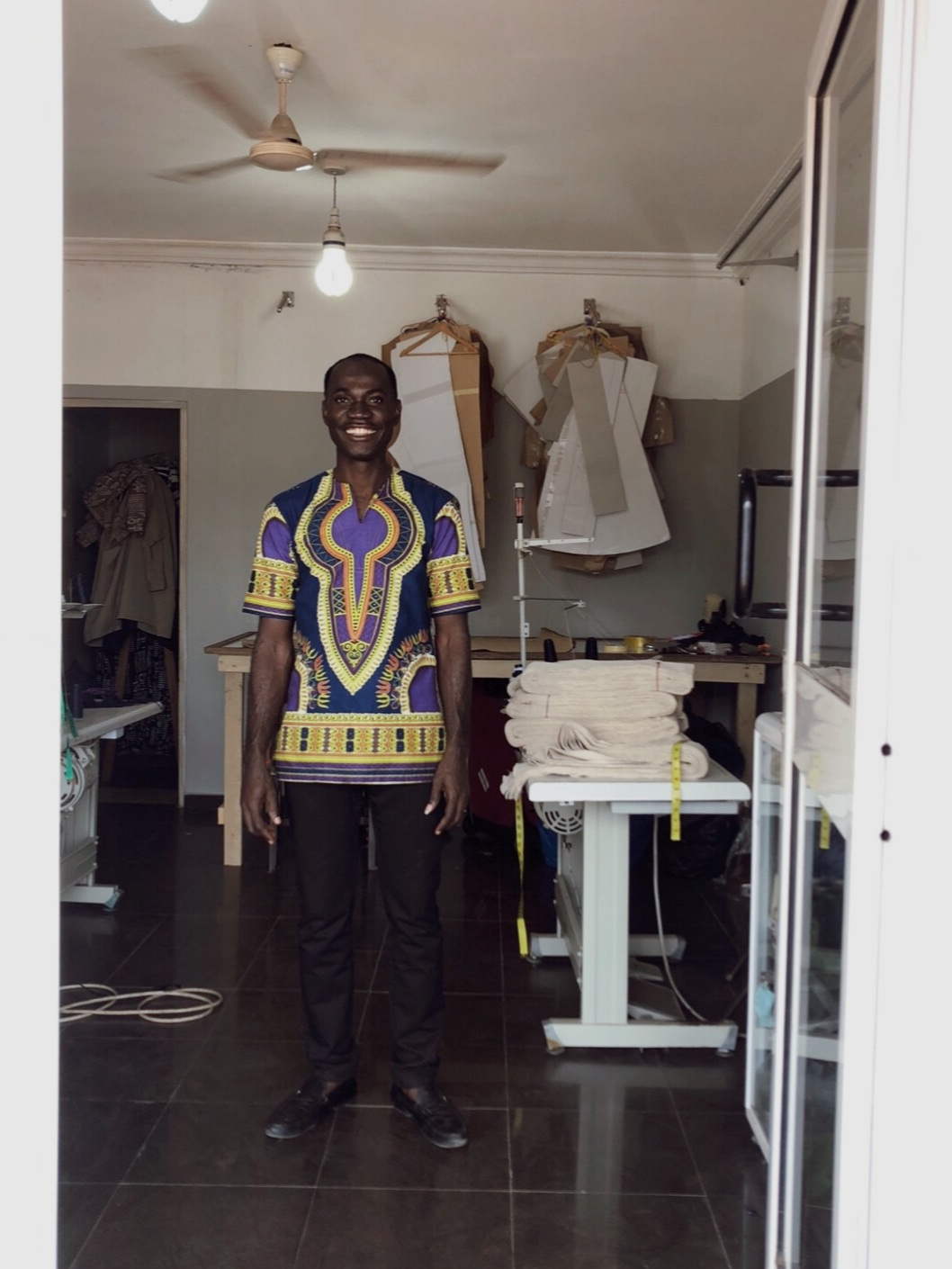 Justice - is our tailor workshop manager. He is in control of the order, coordination and is handling the pattern marking and cutting
