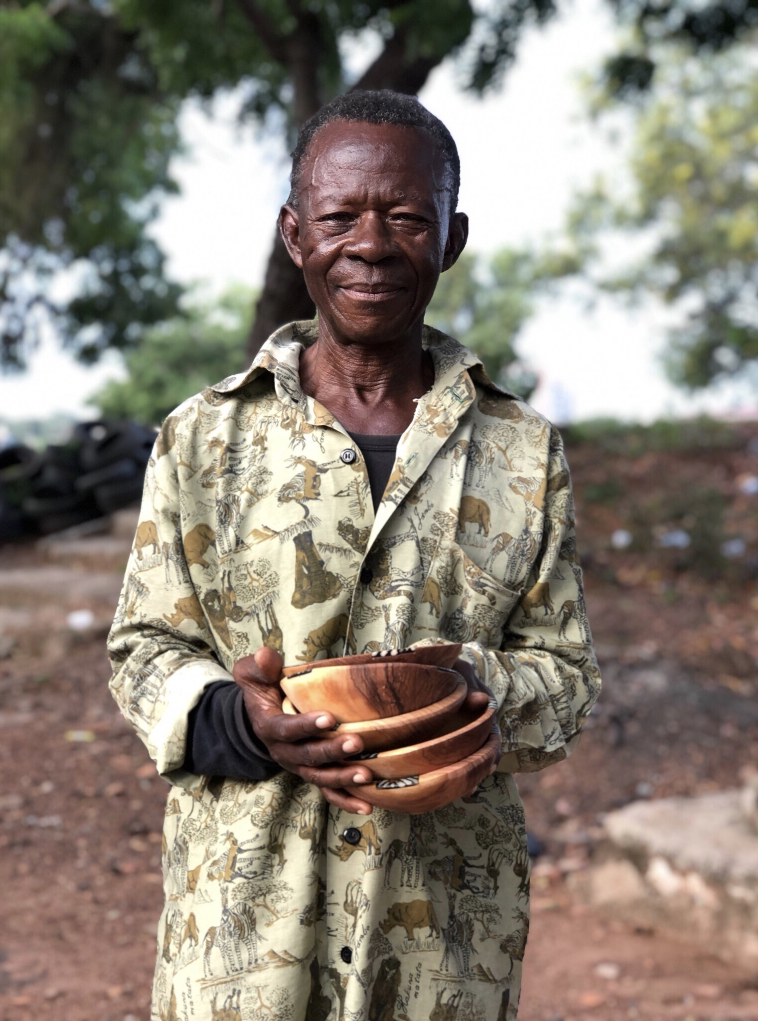 Samuel - is one of the most talented artist in the Accra Region. We are selling his coco ice box and wooden bowls in our studio