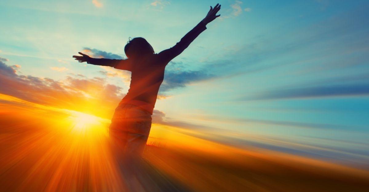 14064-woman-sunset-girl-arms-blue-sky-clouds-silhouette.1200w.tn.jpg