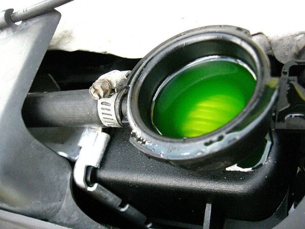 Want to know what color your radiator fluid is? Open the radiator cap. But never when the car is hot!