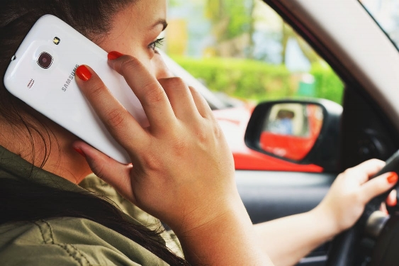 Talking on a cell phone and driving is not illegal. Distracted driving is illegal.