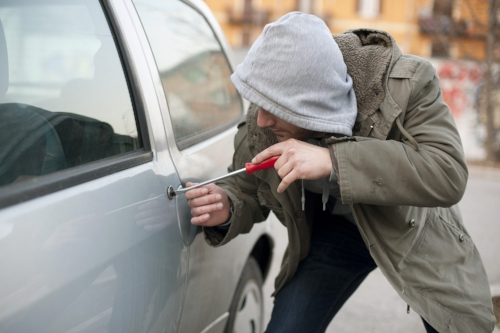 If you stumble upon an auto break-in in process, be safe: get away and call 911.