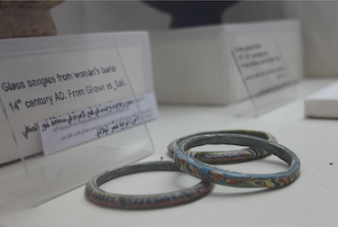 Glass bangles from woman's burial, 14th century AD.