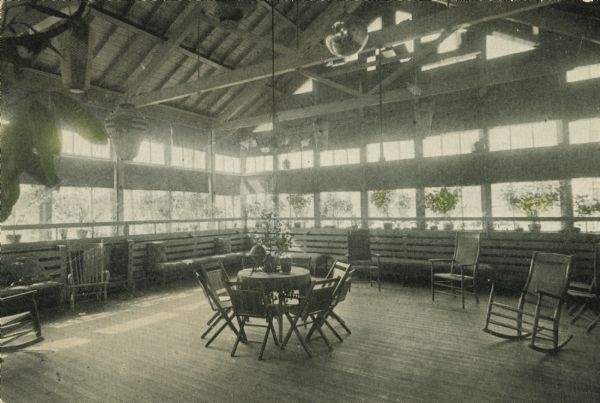 The sun parlor at the Milwaukee Hospital for the Insane with a mirror ball hung from its ceiling. 1912. Image courtesy  Wisconsin Historical Society .