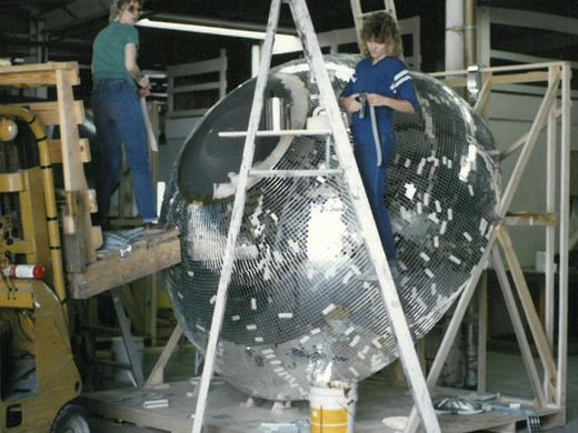 Undated image of Yolanda and her team working on a 10-foot disco ball. Image courtesy  Omega National Products .