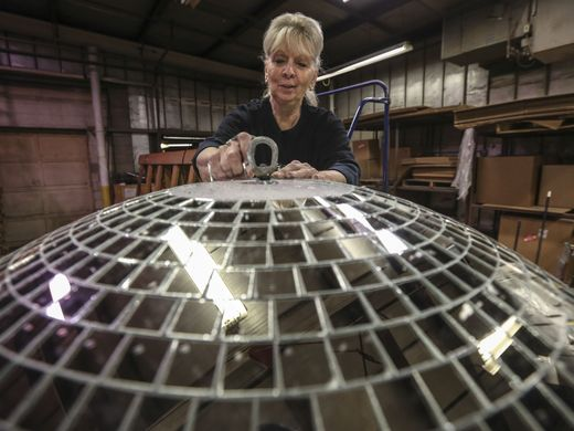 Yolanda in 2016, putting the finishing touches on a disco ball.  Image courtesy Louisville's Courier-Journal.