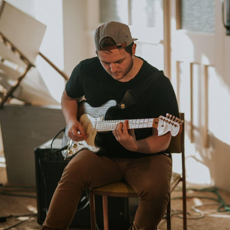 Guitar teacher performing