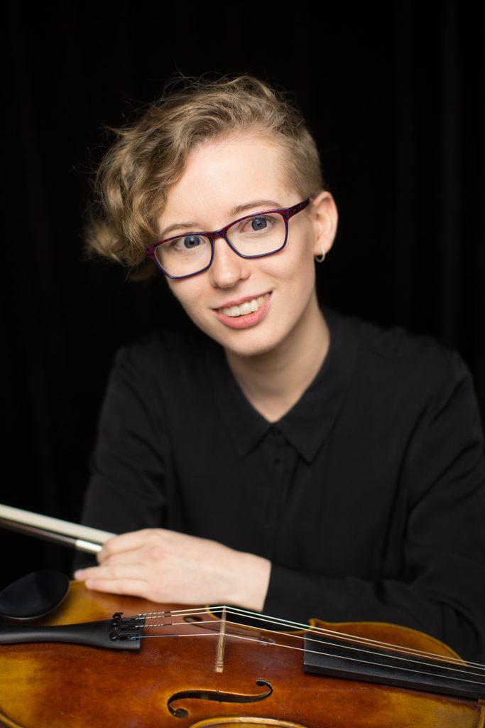 Violin teacher performing