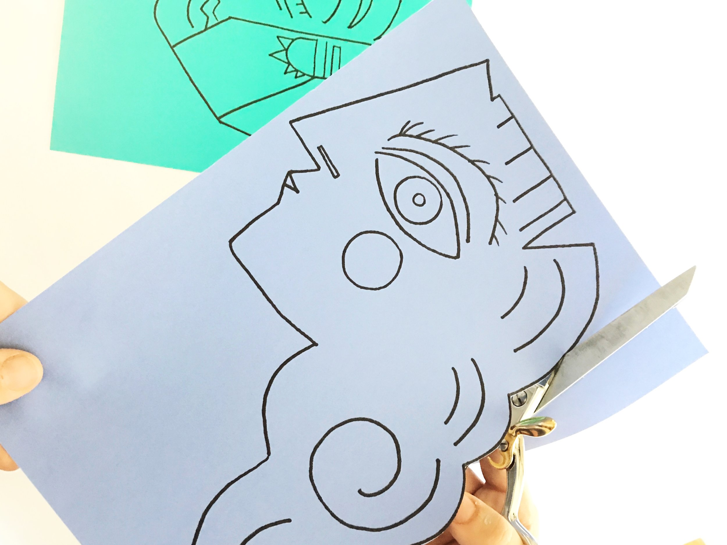Here we printed our face PDF files on teal and periwinkle colored card stock.