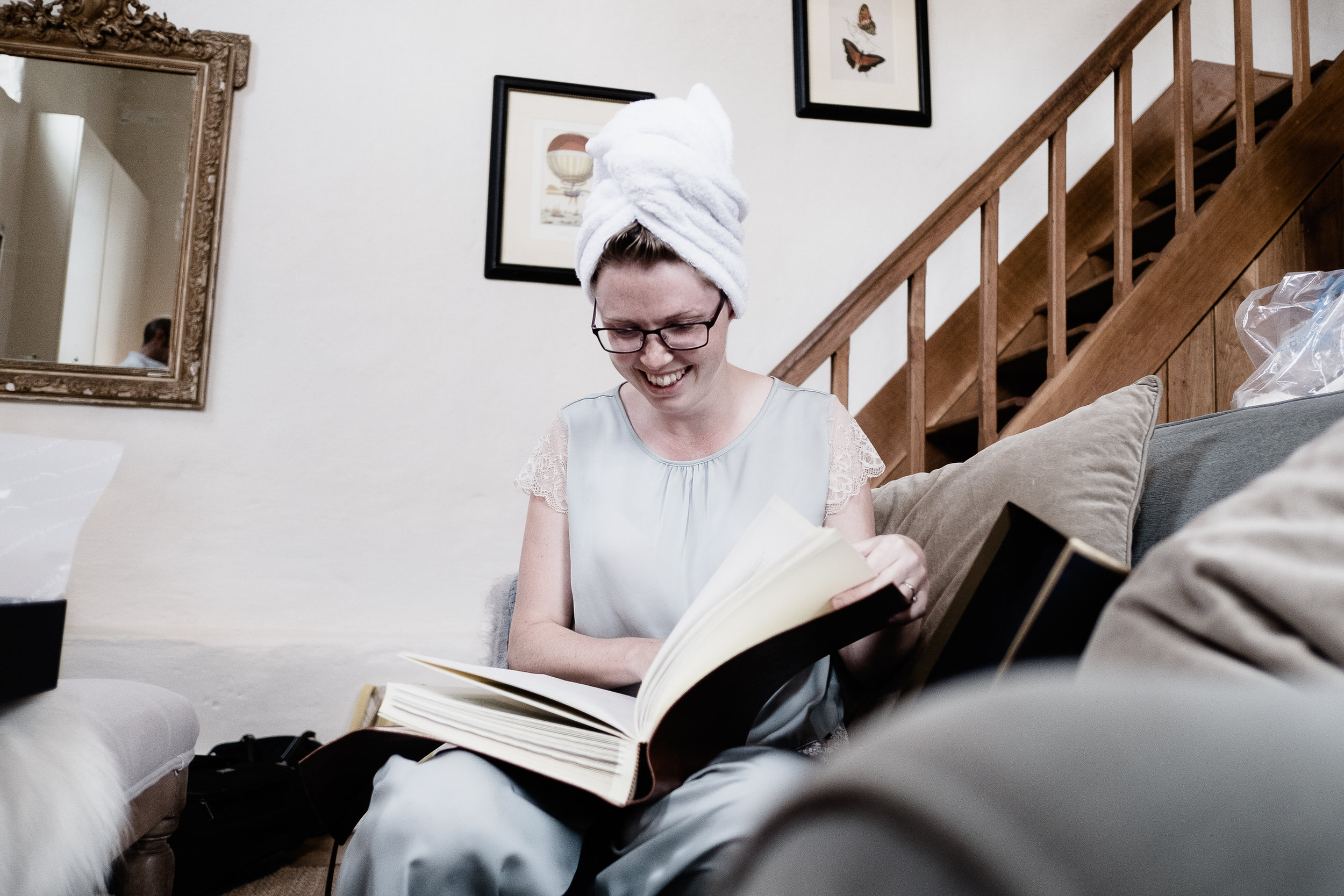 A bride looking at a book  at Merriscourt Wedding Venue, Oxfordshire