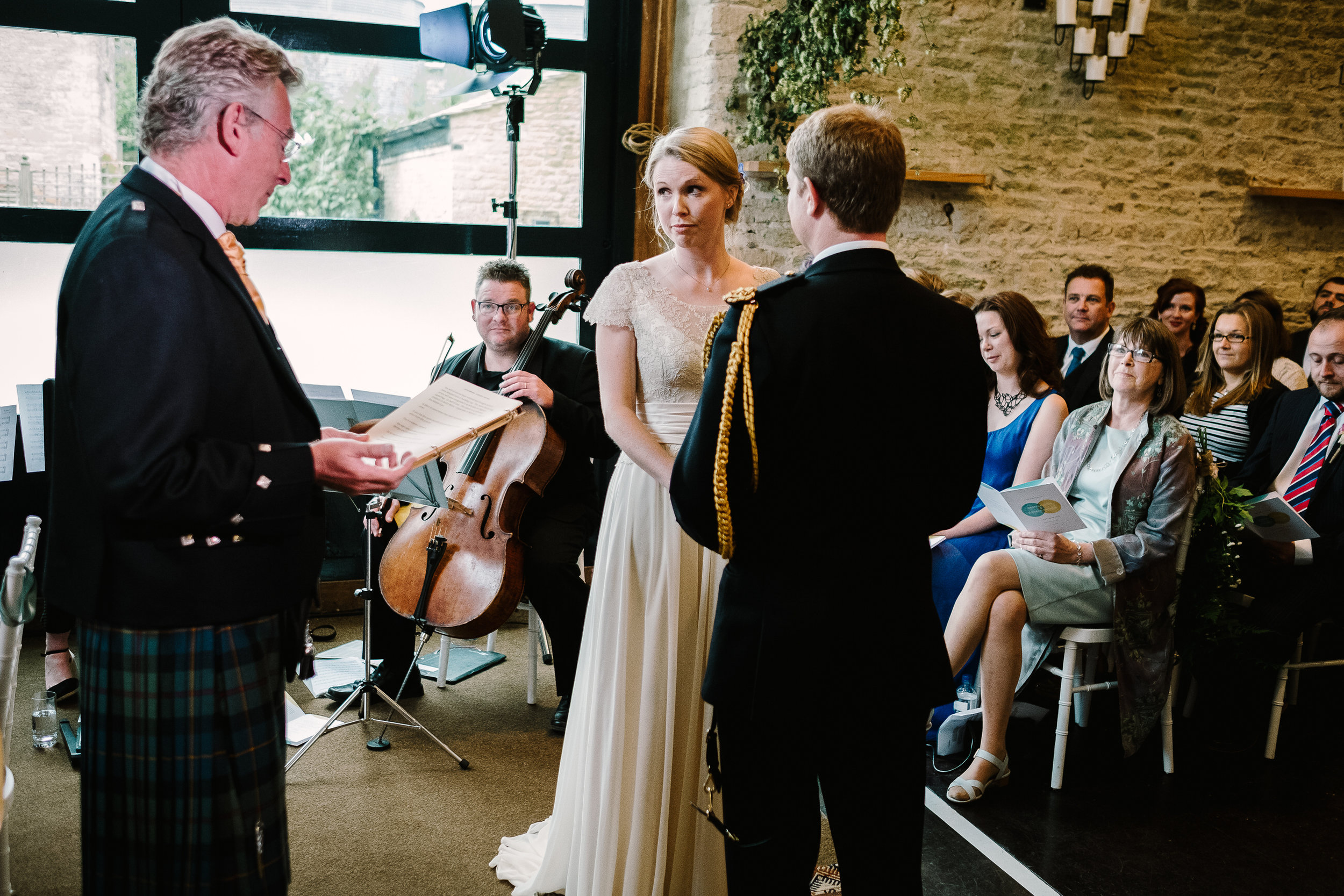 A celebrant leads the ceremony at a wedding at Merriscourt Wedding Venue, Oxfordshire