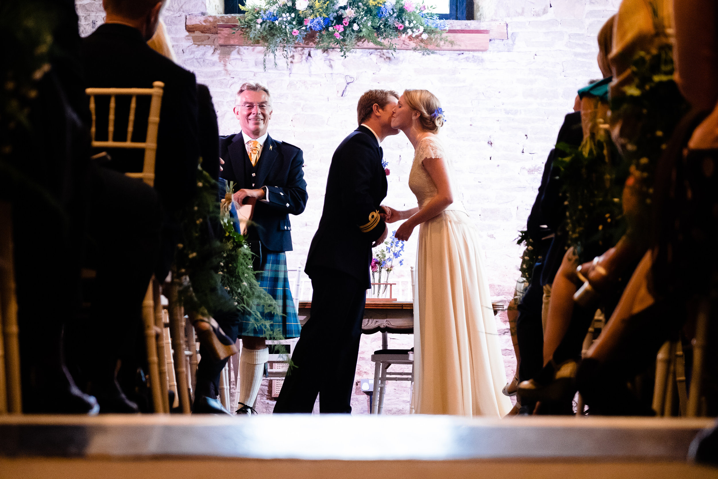 A bride and groom kissing at Merriscourt Wedding Venue, Oxfordshire
