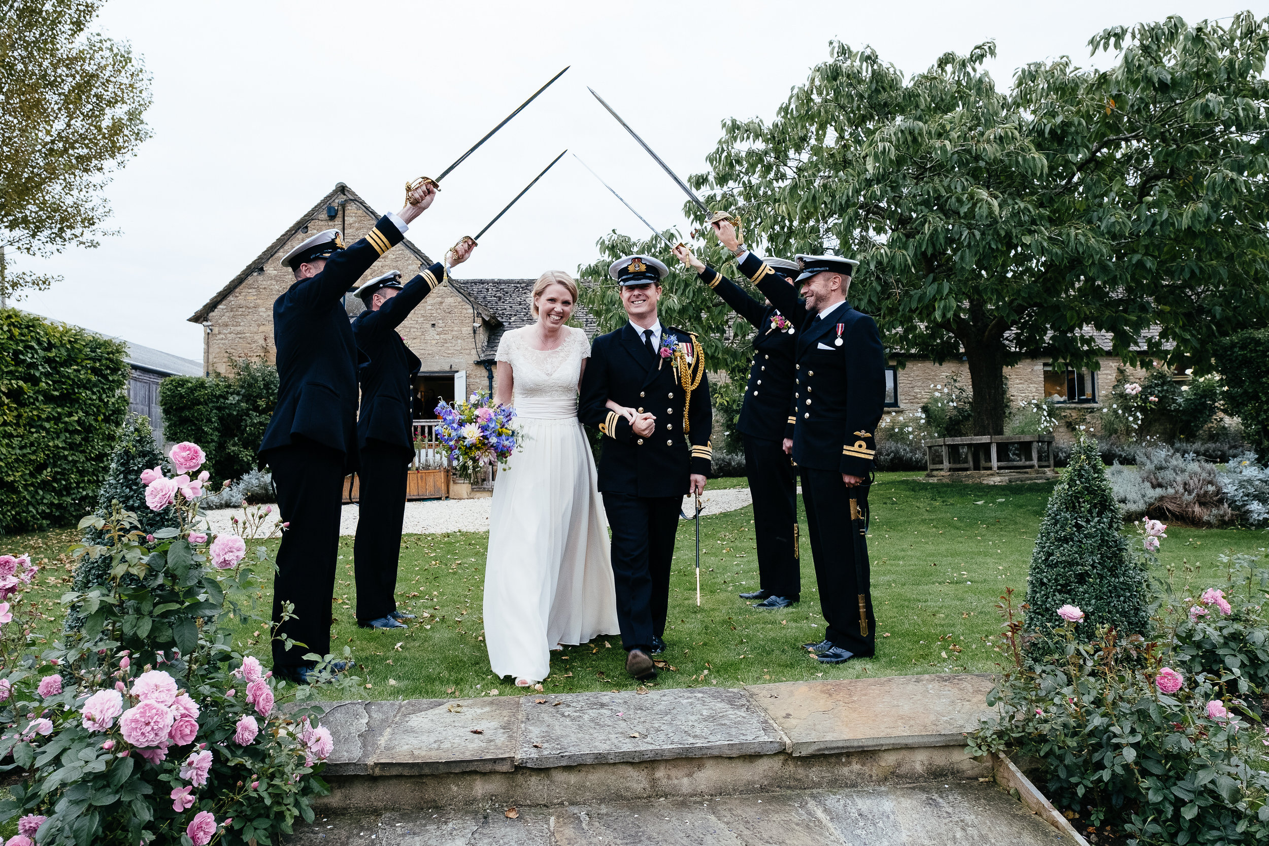 A guard of honor for the bride and groom at Merriscourt Wedding Venue, Oxfordshire