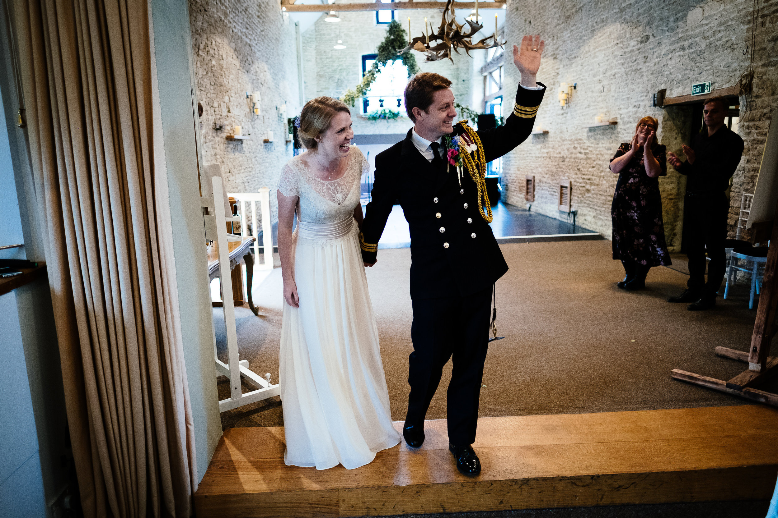 A bride and groom entering the room at a wedding at Merriscourt Wedding Venue, Oxfordshire