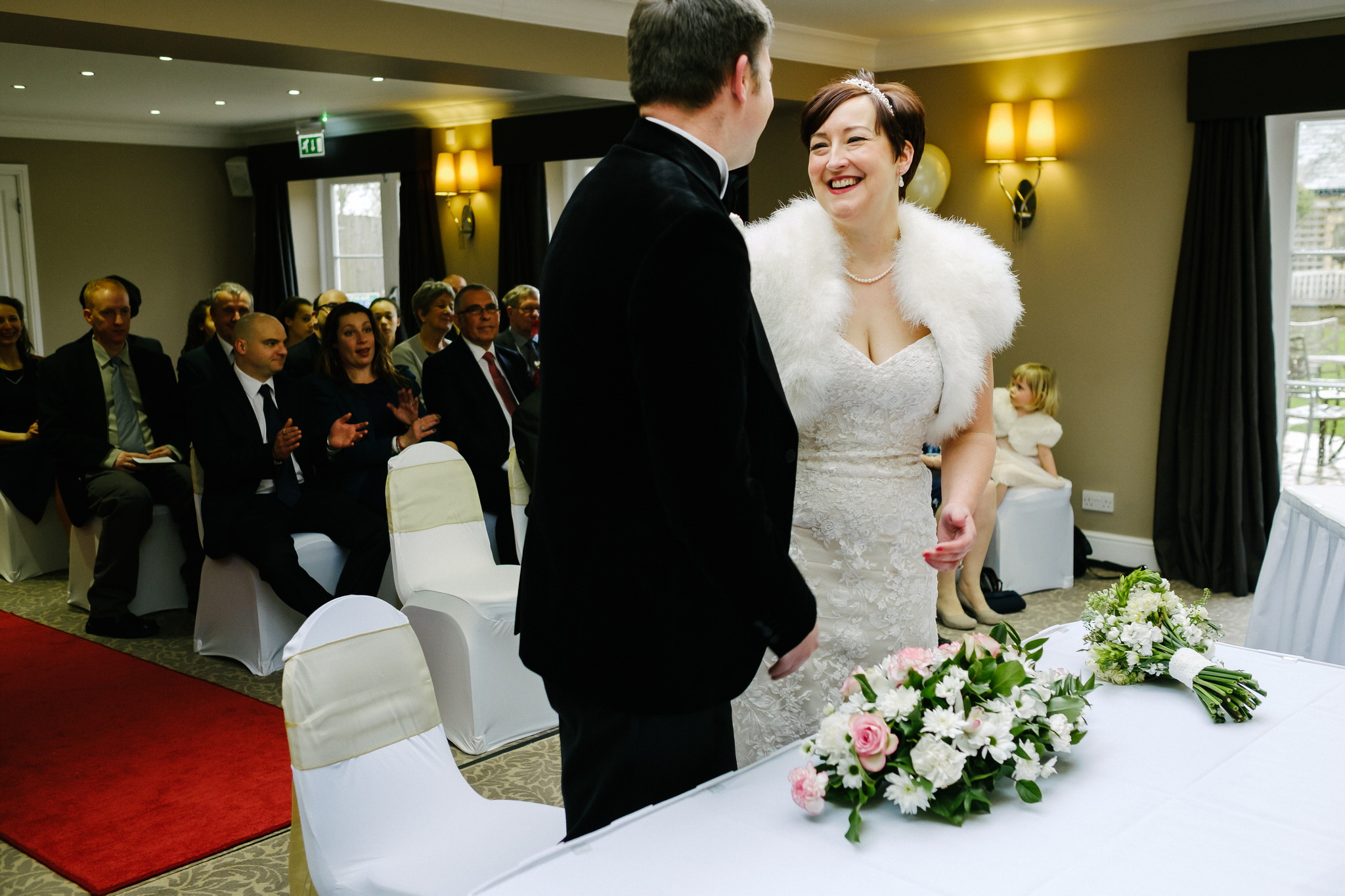 A bride and groom smiling at their wedding at Wroxton House Hotel, Banbury