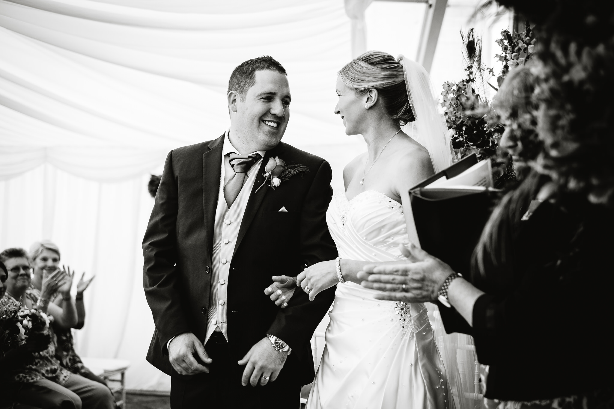 A bride and groom at a wedding at Poundon House, near Bicester, Oxfordshire
