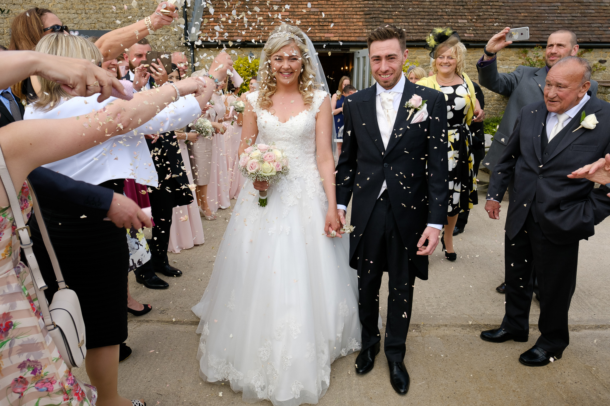 A bride and groom at a wedding at Stratton Court Barn, Bicester, Oxfordshire.