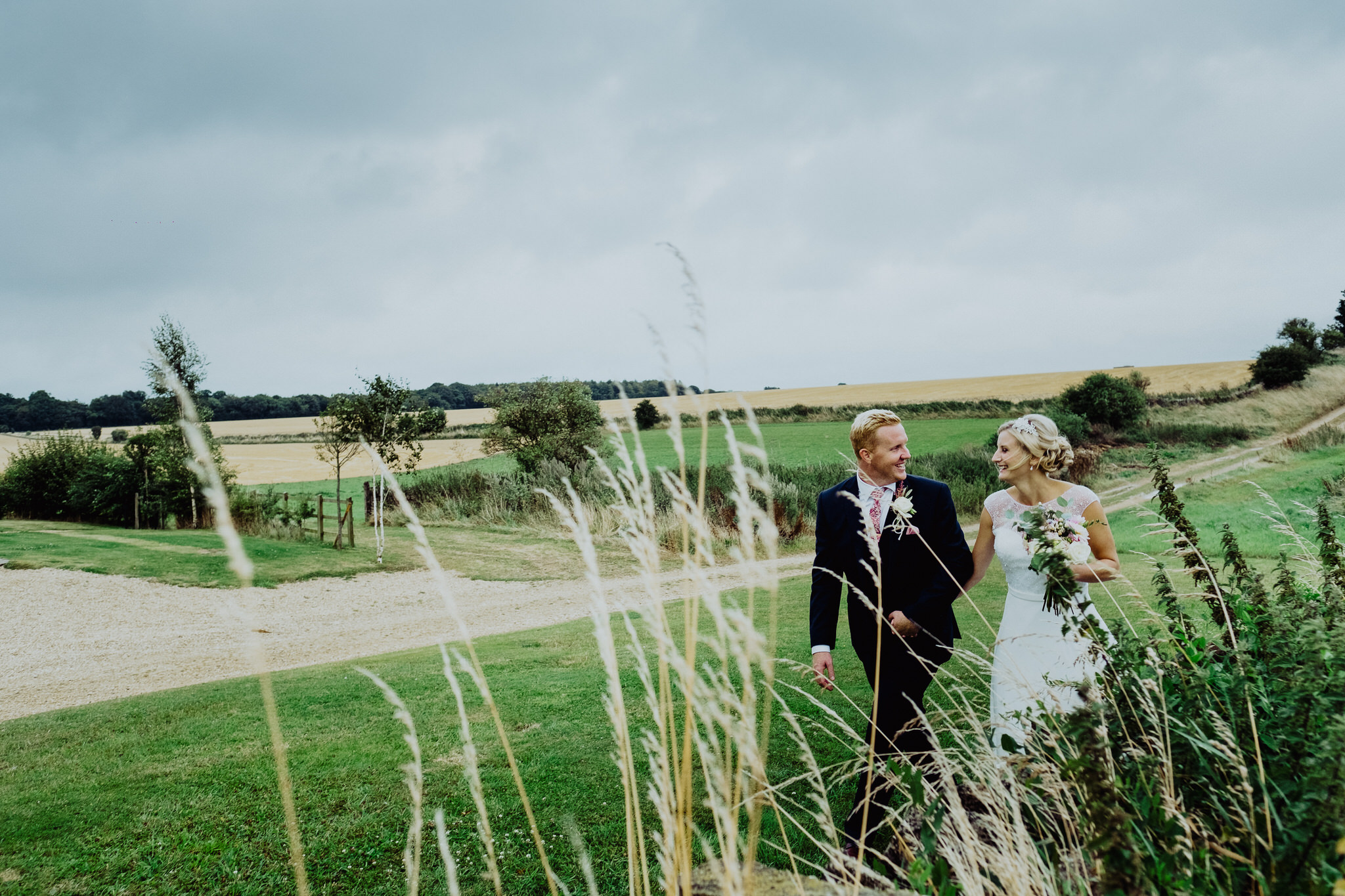 A bride and groom at a wedding at Cripps Stone Barn, Cheltenham, Gloucestershire.