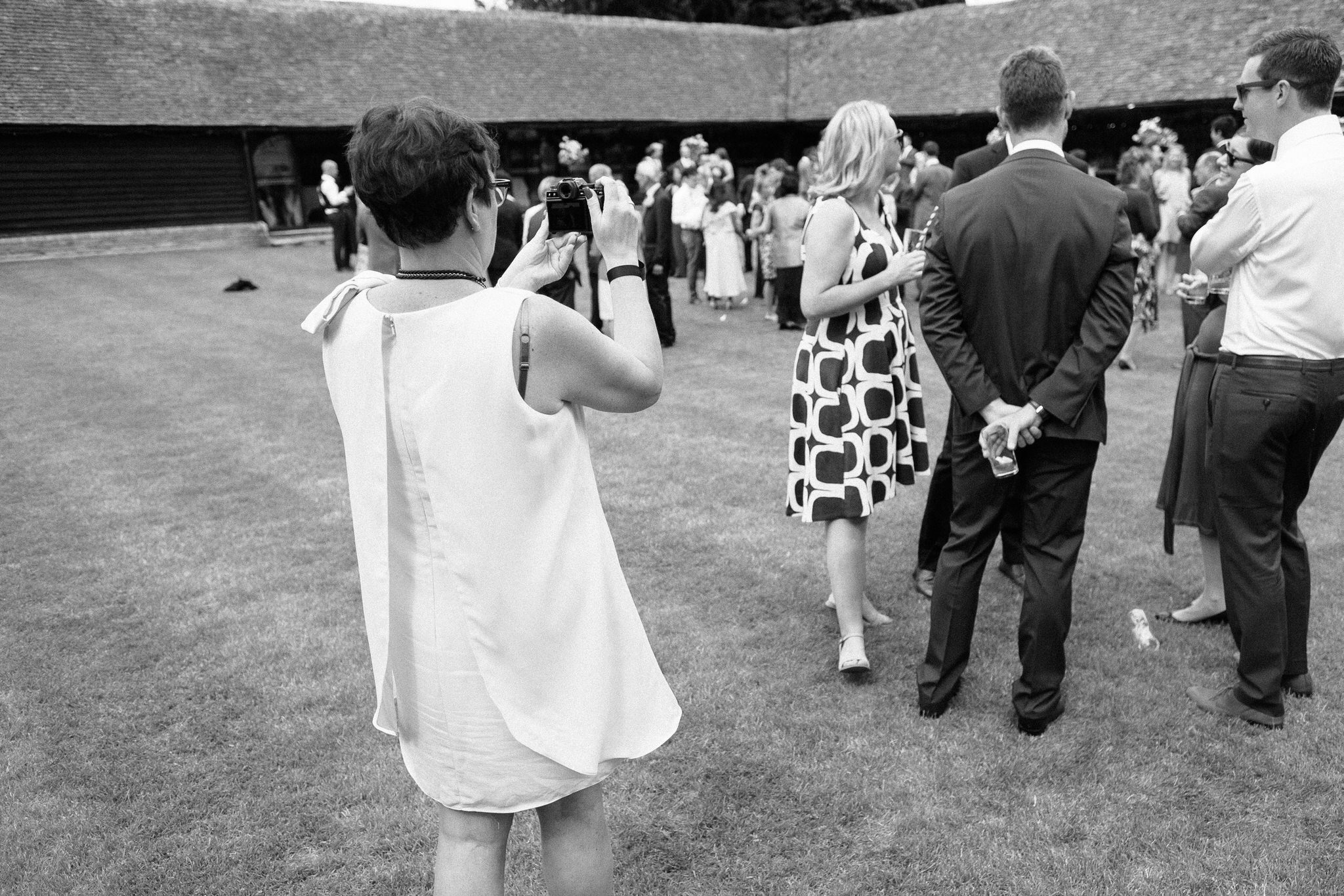 Samantha Vaughan, Owner of Sam and Steve Photography, at a wedding at Lains Barn