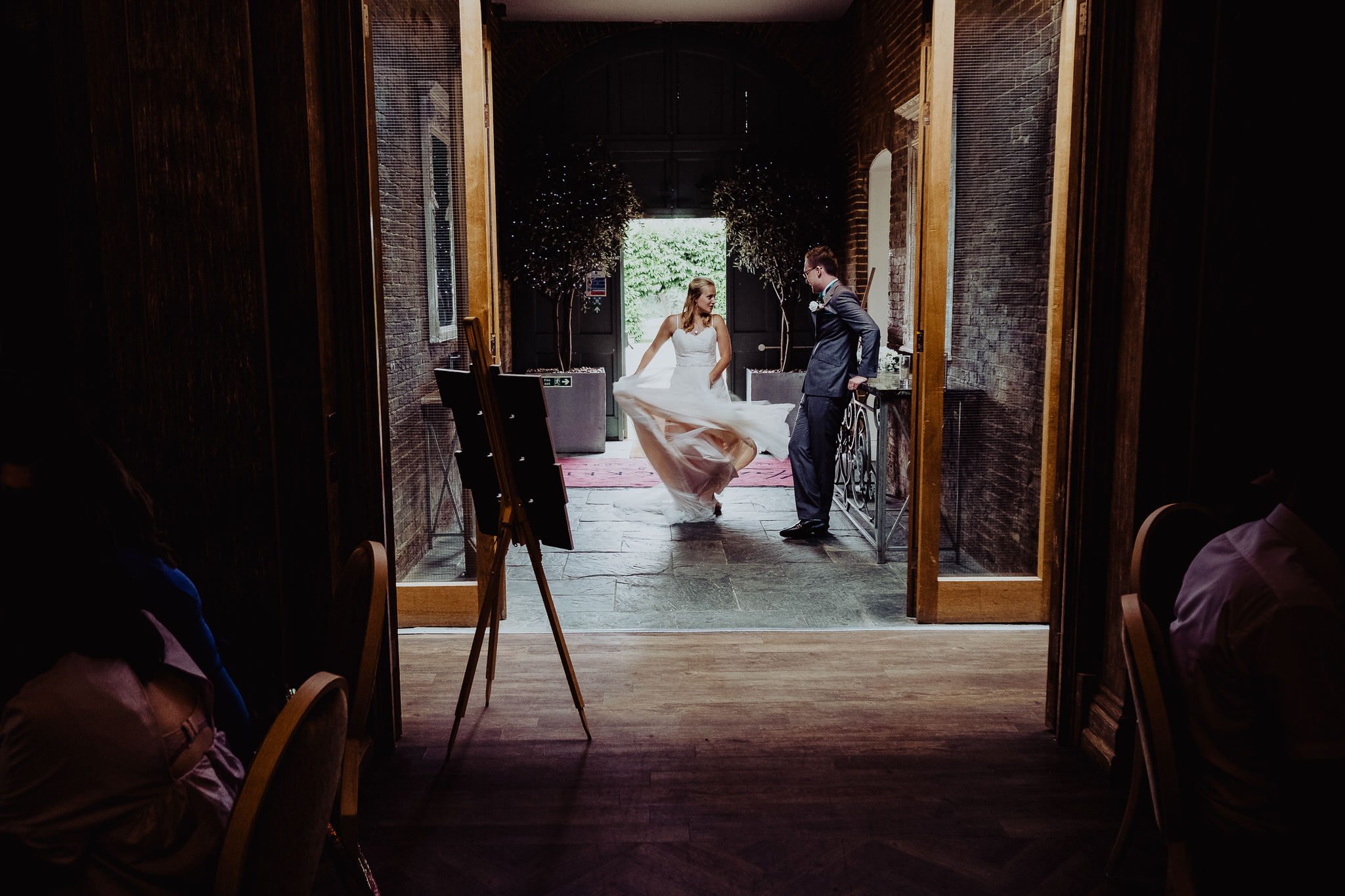 A bride and Groom waiting to join their guests at Fawsley Hall, Northamptonshire.