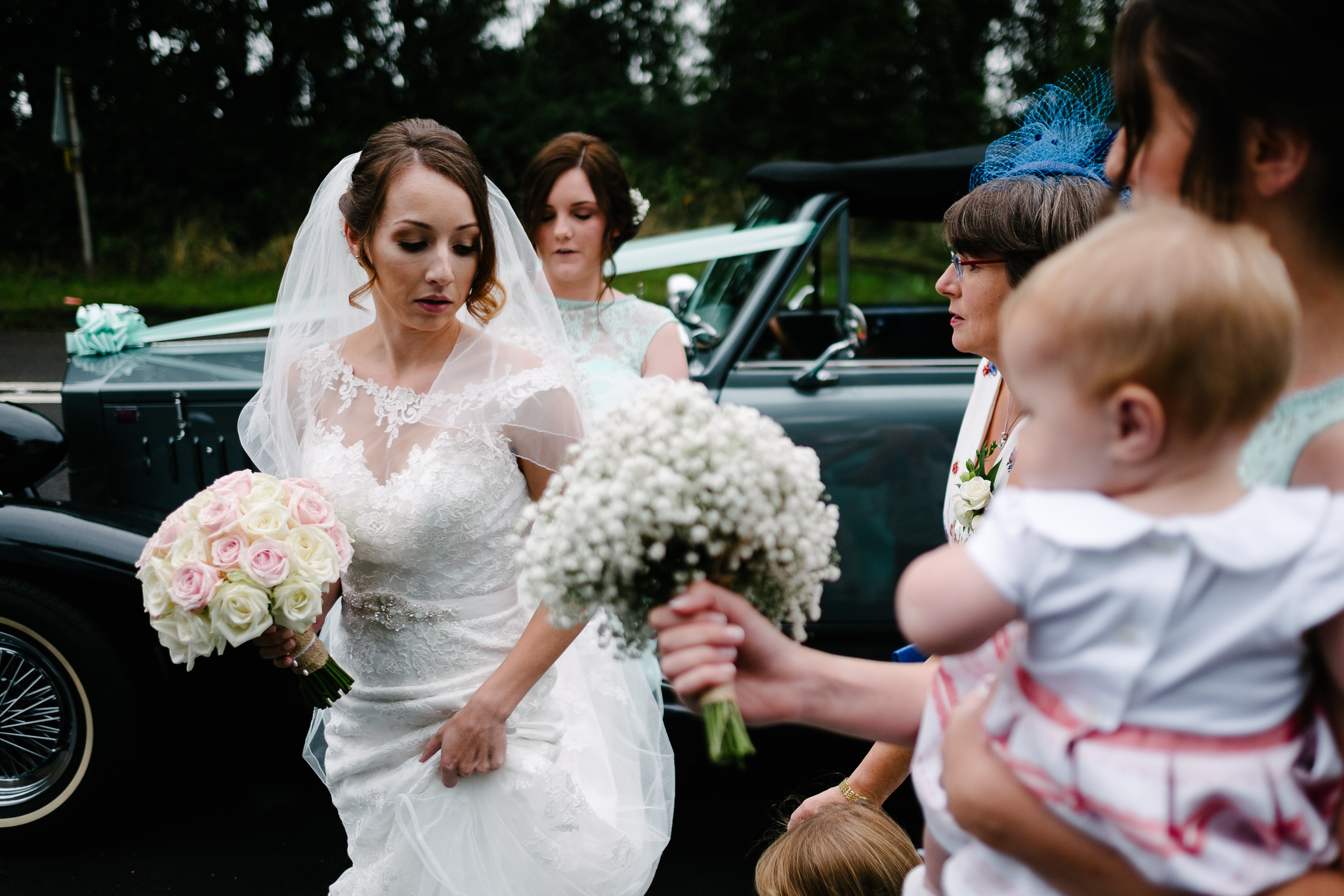 Hannah the bride arriving for her wedding at Stone Church, Near Kidderminster