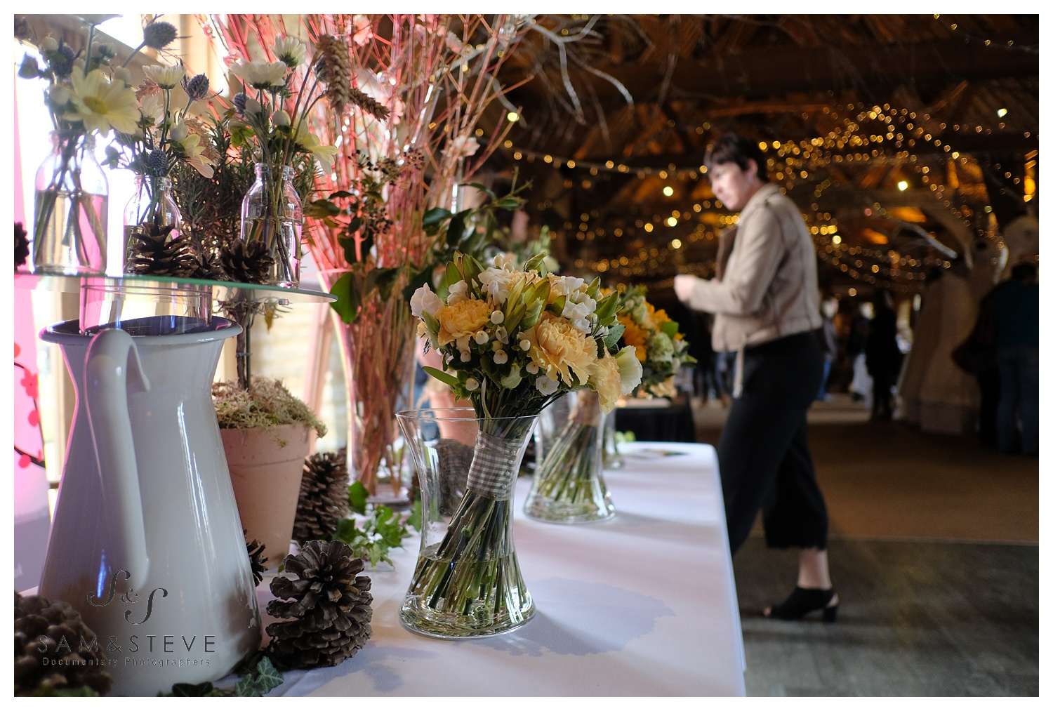 A lovely floral arrangement by  Penny Blossoms at the Tythe Barn wedding fair.
