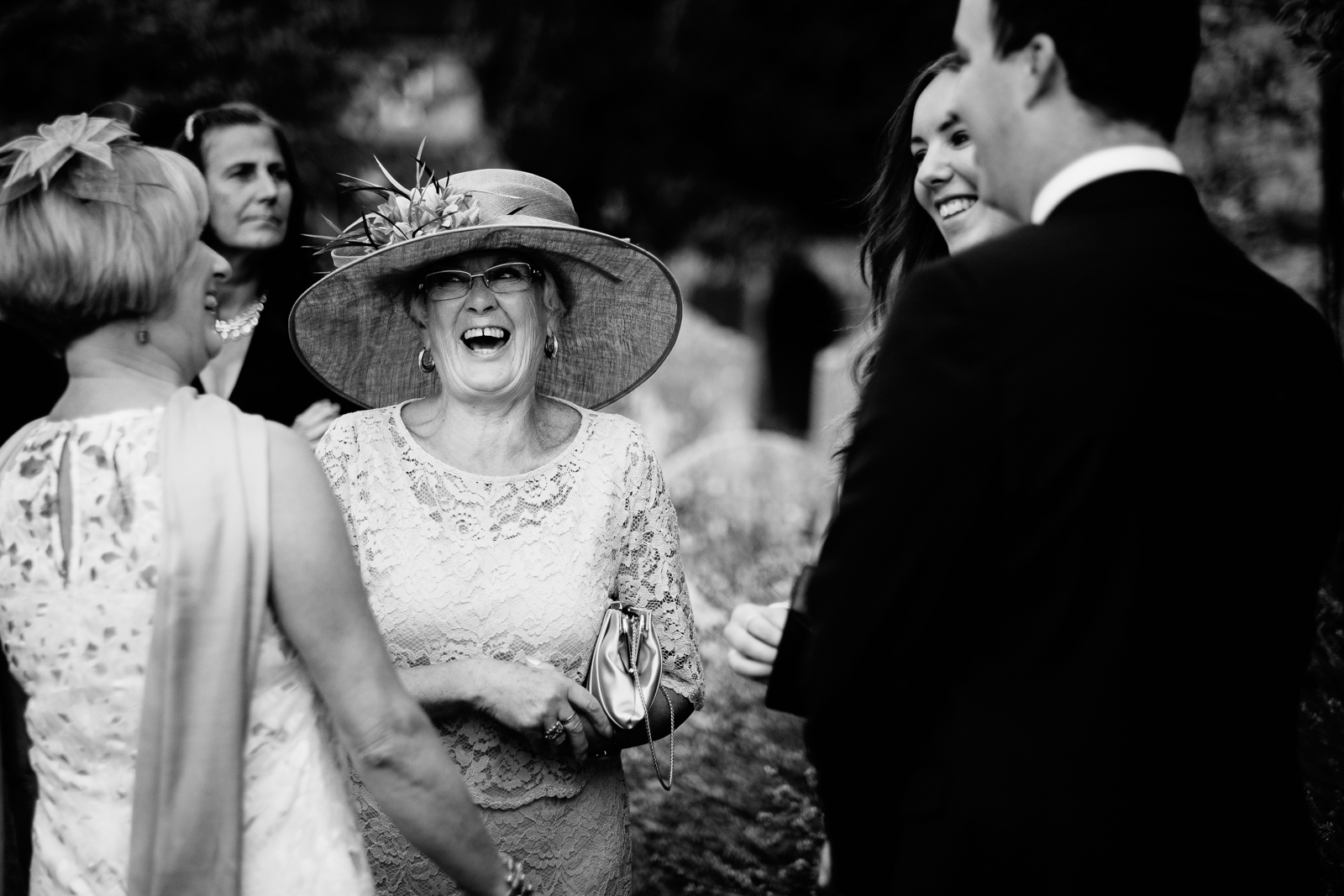 Guests at a wedding at Chinnor Church. By Sam and Steve Photography