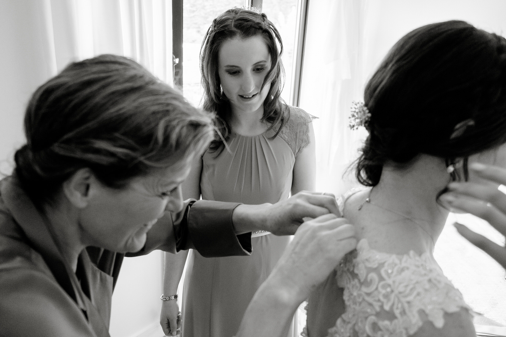 A bride getting ready before her wedding at the Great Barn, Aynho. By Sam and Steve Photography