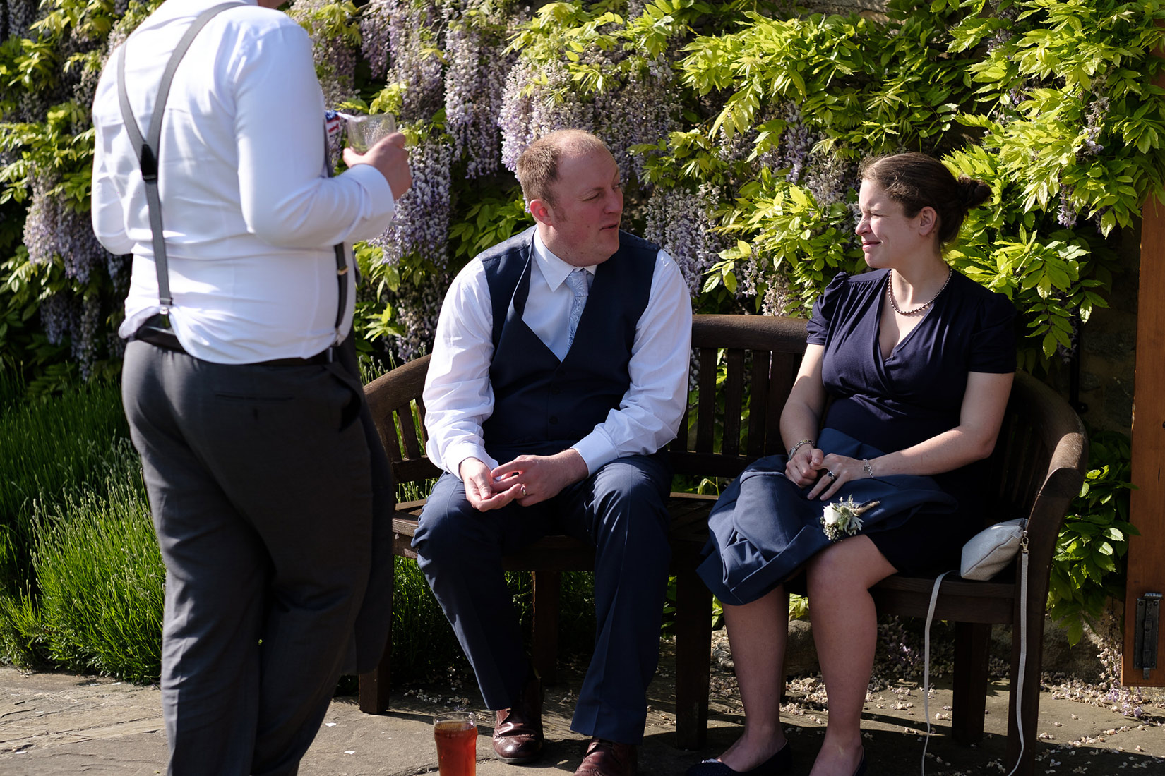 Guests talking outside the Great Barn Aynho