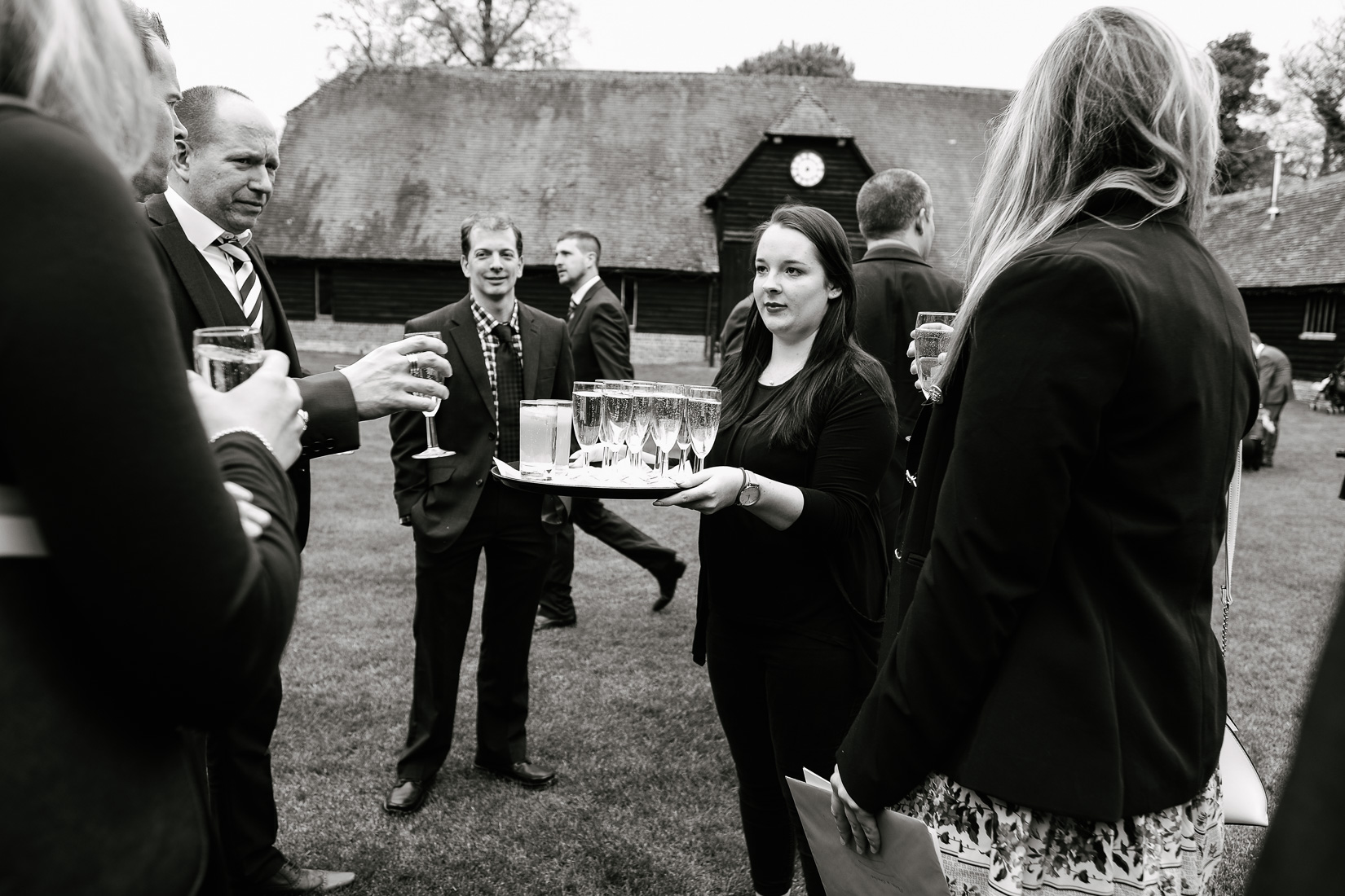 Guests being served drinks at Lains Barn Wedding Venue, Oxfordshire