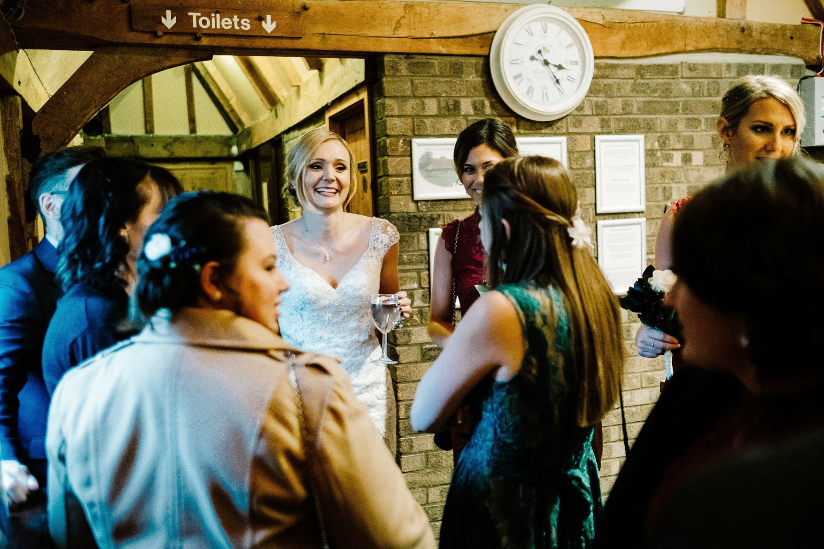 A bride with her guests at Lains Barn Wedding Venue Oxfordshire