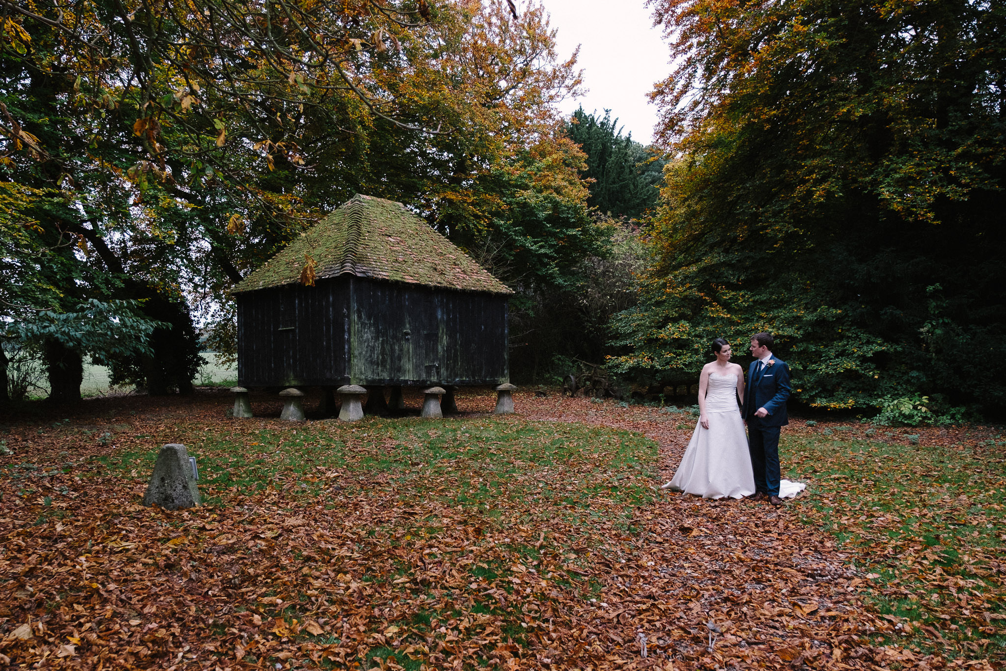 A bride and groom posing for a photo at Lains Barn wedding venue, Oxfordshire