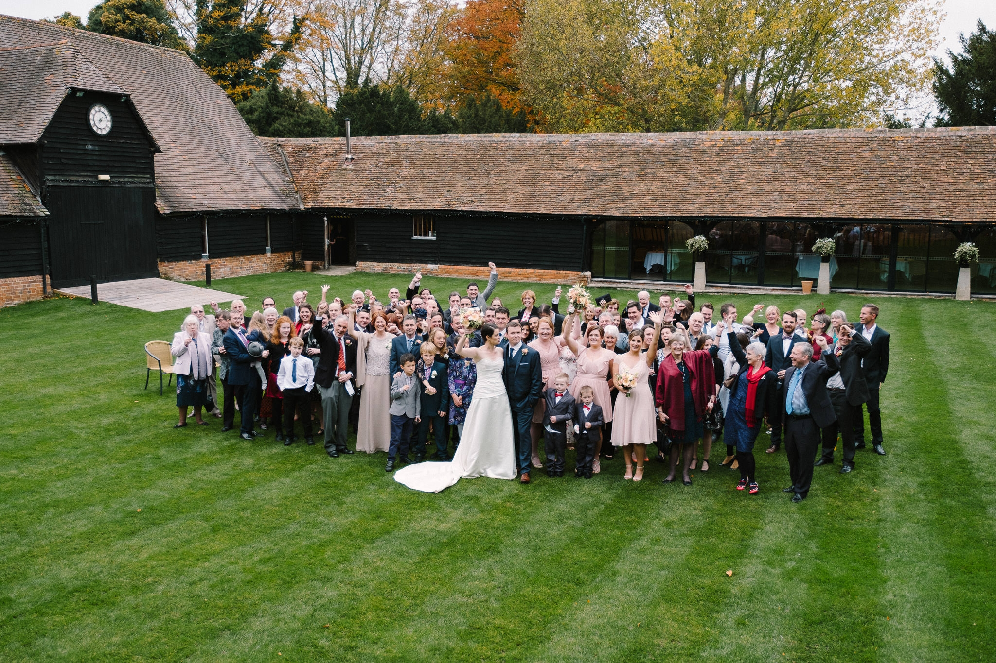 Wedding guests on the lawn at Lains Barn Wedding Venue Oxfordshire