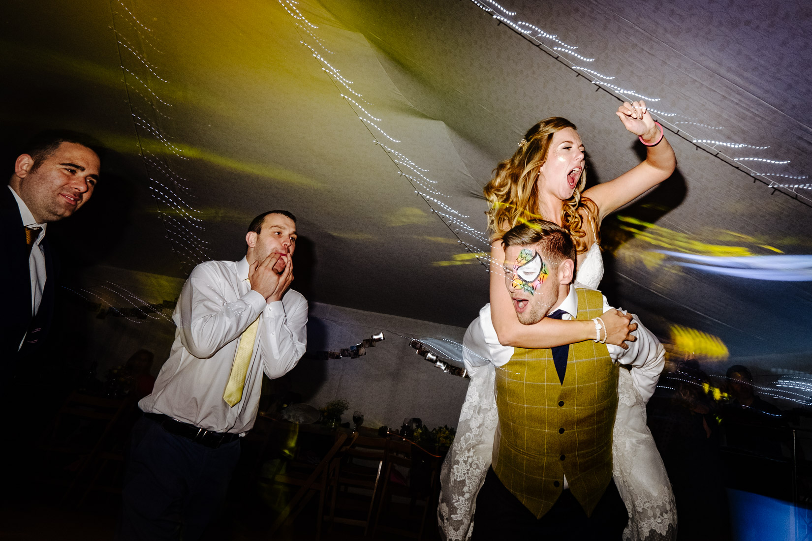 A bride and groom partying at their wedding at the Perch, Oxford.